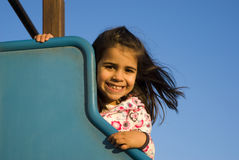 Little girl at playground Stock Photos
