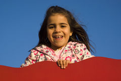 Little girl at playground Stock Photography
