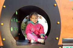 Little girl in playground Stock Images