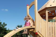 Little girl on playground Stock Photos