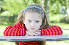 Little girl on the playground Royalty Free Stock Images