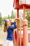 Little Girl on Playground Stock Photo