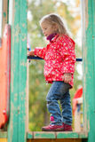 Little girl at the playground Stock Photography