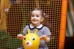Little girl on playground Royalty Free Stock Photos