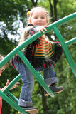 Little girl on playground. Little girl in colored clothing playing on playground Stock Photos