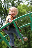Little girl on playground. Little girl in colored clothing playing on playground Royalty Free Stock Photo