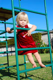 Little girl on playground Royalty Free Stock Photos