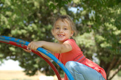 Little Girl on Playground. Little Girl Playing on Playground Royalty Free Stock Image