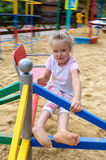 Little girl on playground. Active little girl on playground Royalty Free Stock Images