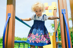 Little girl at playground Stock Image