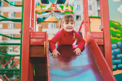 Little girl on the playground. Little girl on the playground descending on a slide Royalty Free Stock Photography