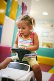 Little girl in playground. Little girl drawing children car. Playfully stock photo
