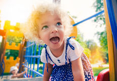 Little girl at playground. Funny  little girl at playground Stock Photography