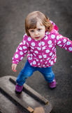 Little girl in a playground Royalty Free Stock Image