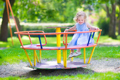 Little girl on a playground Royalty Free Stock Photo