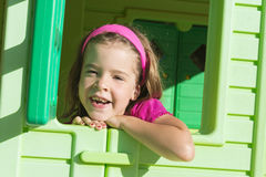 Little girl in playground house Royalty Free Stock Photography