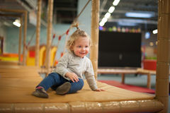 Little girl at the playground. Little girl at the indoors playground Stock Image