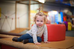 Little girl at the playground. Little girl at the indoors playground Royalty Free Stock Photo