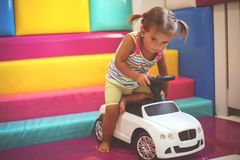 Little girl in playground. Little girl drawing children car. Playfully stock photography