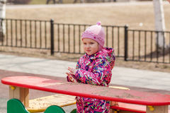 The little girl on the Playground. Royalty Free Stock Photo