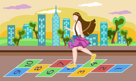 Little girl on playground, playing hopscotch game. Little girl on playground, playing hopscotch Royalty Free Stock Photography