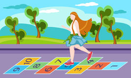 Little girl on playground, playing hopscotch game Royalty Free Stock Image