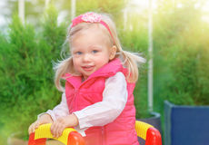 Little girl on playground Royalty Free Stock Photography