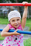 Little girl on a playground Royalty Free Stock Photos