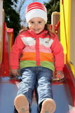 Little Girl on Playground Ready to Slide. Down Stock Photography