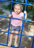 Little girl on the playground rises Royalty Free Stock Images