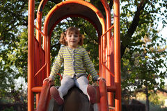Little girl on playground slide. Portrait Royalty Free Stock Image