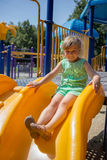 Little girl on the playground. In summer Stock Images