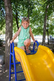 Little girl on the playground. In summer Royalty Free Stock Photo
