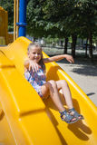 Little girl on the playground. In summer Royalty Free Stock Image