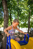 Little girl on the playground. In summer Royalty Free Stock Photography