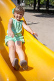Little girl on the playground. In summer Royalty Free Stock Images