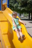 Little girl on the playground. In summer Stock Photo