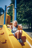 Little girl on the playground. In summer Stock Photography