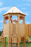 Little girl in playground tower stock image