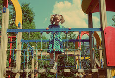 Little girl on playground - vintage retro style Stock Photo