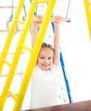 Little girl on a playground Stock Image