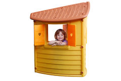 Little girl in playhouse toy Royalty Free Stock Photos