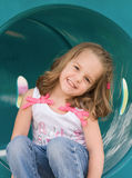 Little Girl Playing. Girl Playing at the Playground Stock Images