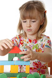 Little girl playing. With cubes Stock Image