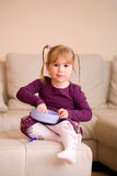Little girl playing Stock Images