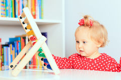Little girl playing with abacus Stock Photo