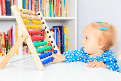 Little girl playing with abacus Royalty Free Stock Images