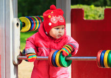 Little girl playing with abacus on playground Stock Images