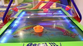 Air hockey, children`s playroom slots, children`s entertainment, Games For Children. Little girl playing air hockey game stock video footage