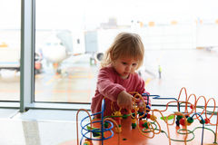Little girl playing in airport. Kids travel Royalty Free Stock Images
